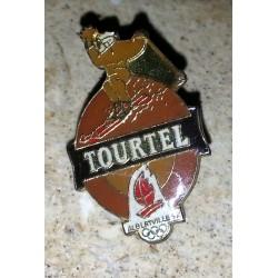 Ancien pin's collection tourtel + attache métal