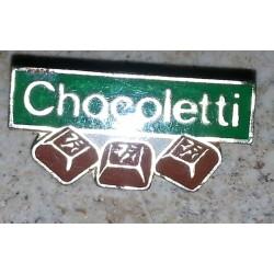 Ancien pin's collection chocoletti + attache métal