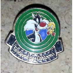Ancien pin's collection festival des cartoons + attache métal