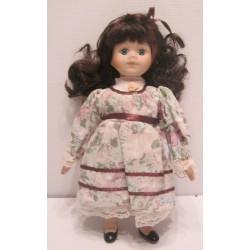 Ancienne petite poupée de collection brune yeux bleus robe fleuries Collection